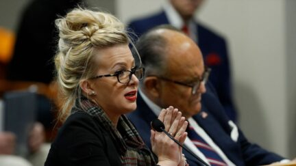 Mellissa Carone, who was working for Dominion Voting Services, speaks in front of the Michigan House Oversight Committee in Lansing, Michigan on December 2, 2020. - The president's attorneys, led by Rudy Giuliani, have made numerous allegations of election fraud.