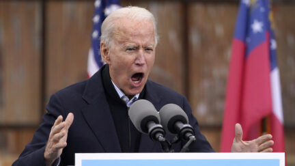 ATLANTA, GA - DECEMBER 15: U.S. President-elect Joe Biden delivers remarks during a drive-in rally for U.S. Senate candidates Jon Ossoff and Rev. Raphael Warnock at Pullman Yard on December 15, 2020 in Atlanta, Georgia. Biden's stop in Georgia comes less than a month before the January 5 runoff election for Ossoff and Warnock as they try to unseat Republican incumbents Sen. David Perdue and Sen. Kelly Loeffler.