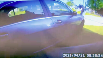 This screengrab from an officer's body camera video shows the moment when prosecutors say the first shot was fired at Andrew Brown, Jr.