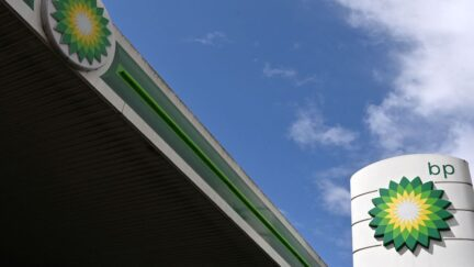 BP logos are pictured at a BP petrol and diesel filling station in north London on May 12, 2021