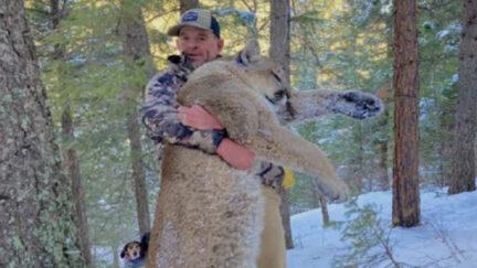 Patrick Montgomery holding up dead moutain lion. copy