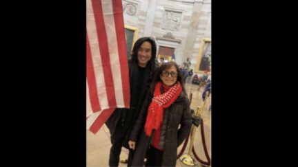 Antony Vo and his mother pose inside the U.S. Capitol