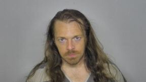 Derek Dillman appears in a mugshot