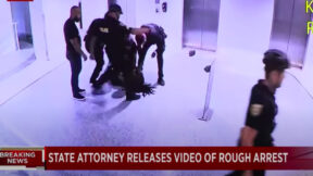 Miami Beach Police officers arresting Daltona Crudup.
