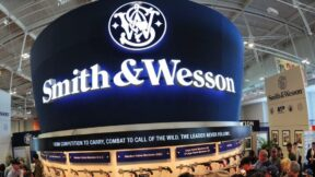 Convention goers look at weapons at the Smith and Wesson booth