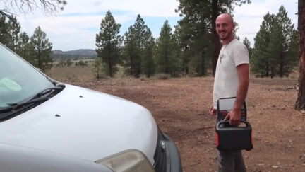 Brian Laundrie is seen after closing the hood of the white van he and Gabby Petito used to travel across the country while documenting their journey online. (Image via screengrab from Nomadic Statik/YouTube.)
