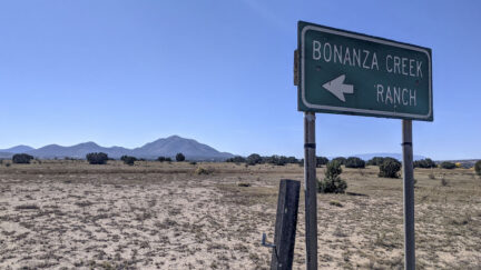A sign points to the direction of the Bonanza Creek Ranch where a fatal shooting occurred on a movie set on October 22, 2021 in Santa Fe, New Mexico. Director of Photography Halyna Hutchins was killed and director Joel Souza was injured on set while filming the movie